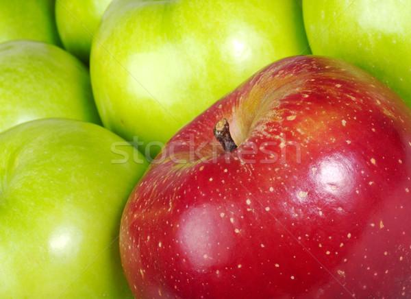 Red Apple in between Green Apples Stock photo © ildi