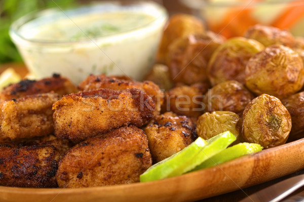 Breaded Calamary with Baked Potatoes Stock photo © ildi