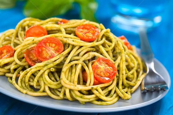 Spagetti pesto domates kiraz domates hizmet Stok fotoğraf © ildi