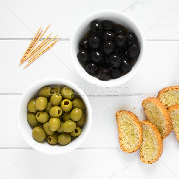 Black and Green Olives with Crostini Stock photo © ildi