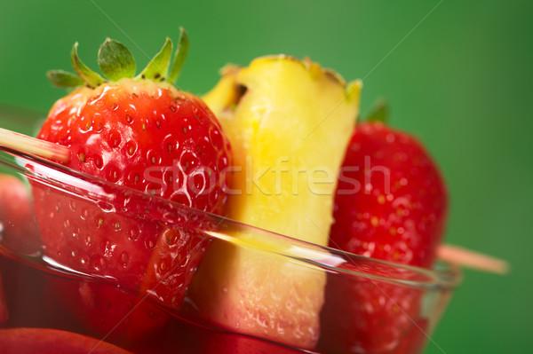Strawberry and Pineapple Garnish on Glass Stock photo © ildi