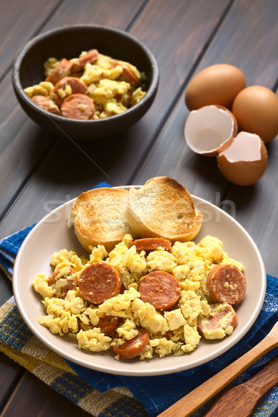 Scrambled Eggs with Chorizo Slices and Onion Stock photo © ildi