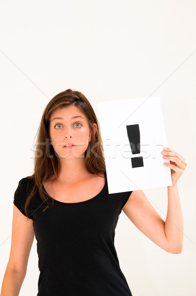 portrait young woman with board exclamation point  Stock photo © ilolab