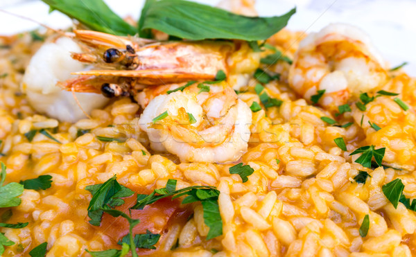 Tasty risotto with Shrimp, fresh herbs vegetables on a white pla Stock photo © ilolab