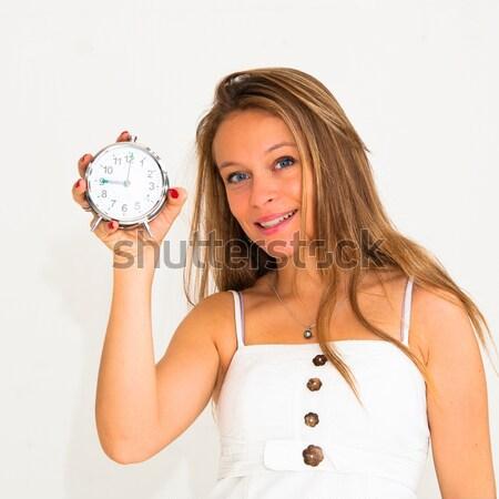 Genç kadın çalar saat güzel mutlu Stok fotoğraf © ilolab