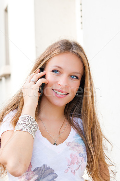 Portrait of a smiling young businessman giving call me gesture o Stock photo © ilolab