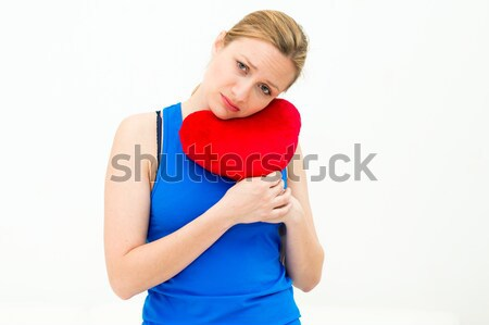lonely sad woman holding red valentine heart Stock photo © ilolab