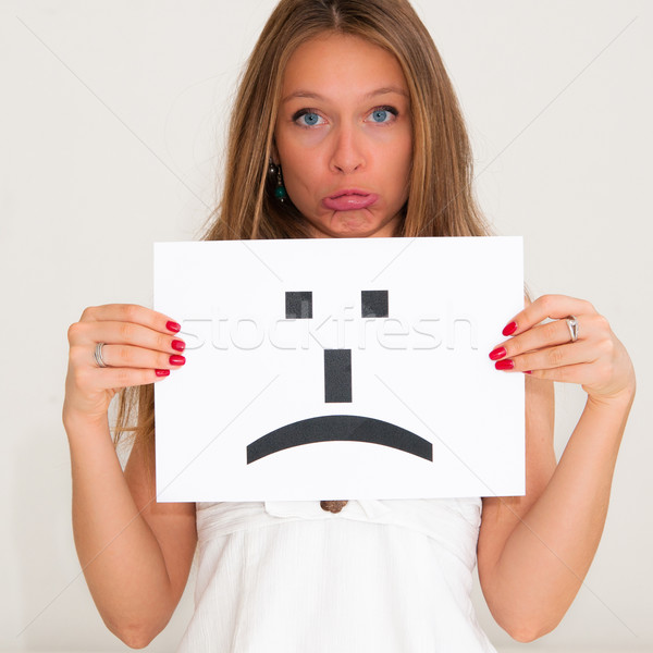 woman with board sad emoticon face sign  Stock photo © ilolab