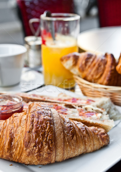 Breakfast with coffee and croissants in a basket on table Stock photo © ilolab