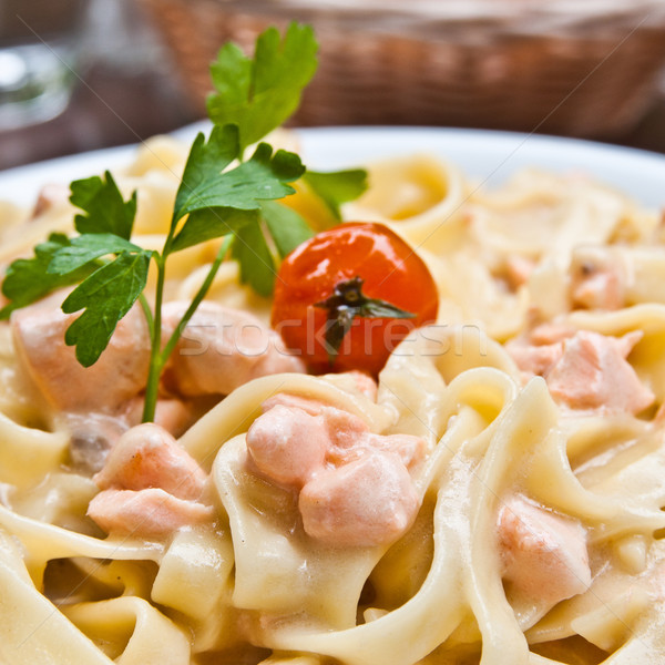 close-up of plate of pasta and smoked salmon with tomato Stock photo © ilolab