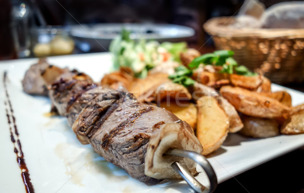 tasty grilled meat and vegetables skewers on a slate plate Stock photo © ilolab