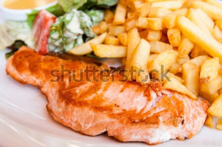 grilled salmon and lemon - french cuisine dish with tomato and s Stock photo © ilolab