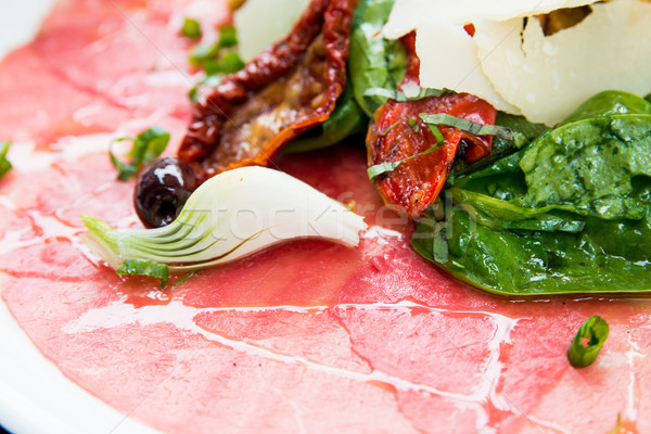 carpaccio-Fresh Sliced raw beef meat Stock photo © ilolab
