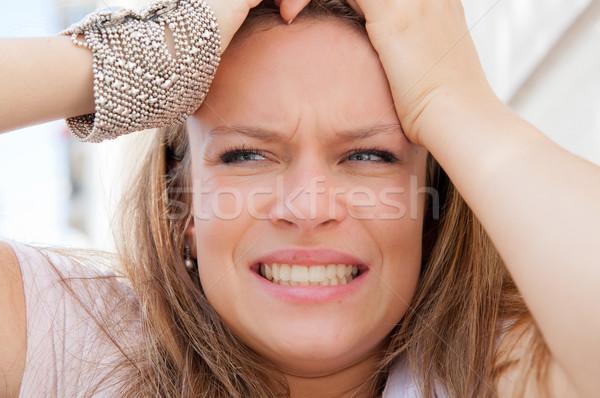 молодые паника женщину рук голову глазах Сток-фото © ilolab