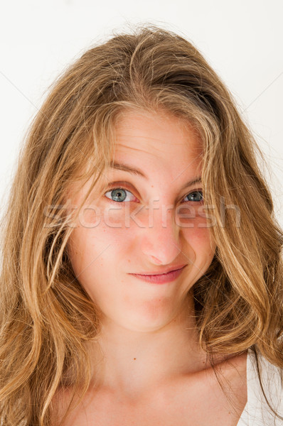 expression-Young woman making a funny grimace  Stock photo © ilolab