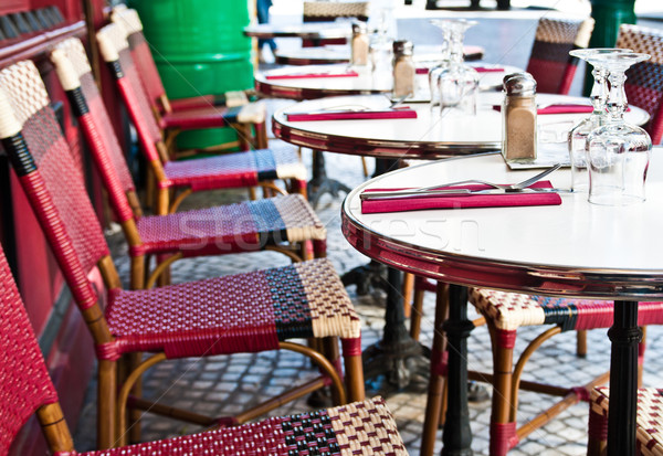 Street view of a Cafe terrace with empty tables and chairs,paris Stock photo © ilolab