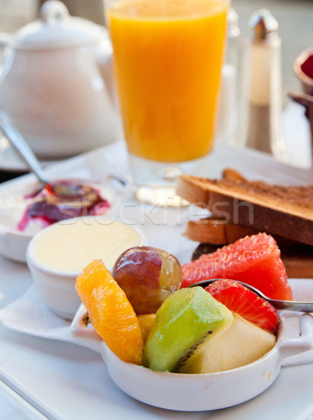 Breakfast with orange juice and fresh fruits Stock photo © ilolab