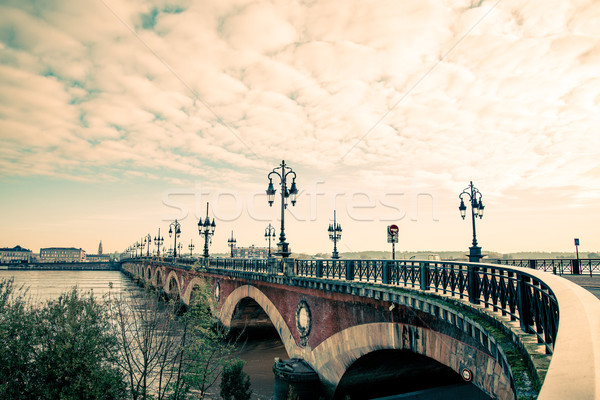 Bordeaux river bridge with St Michel cathedral Stock photo © ilolab