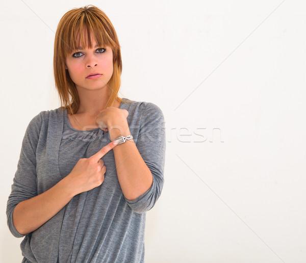 Gyönyörű fiatal nő idő karóra kéz portré Stock fotó © ilolab