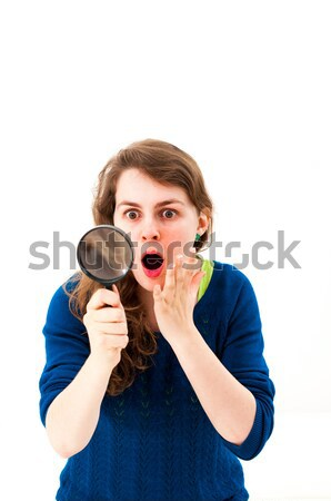 Dramatic woman with magnifying glass Stock photo © ilolab