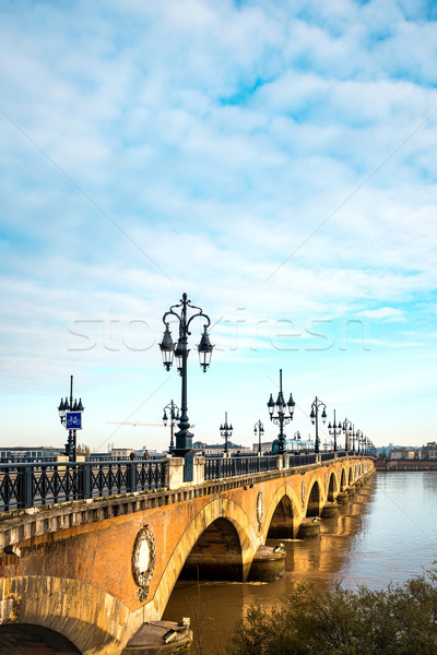 Bordeaux river bridge with St Michel cathedral Stock photo © ilolab