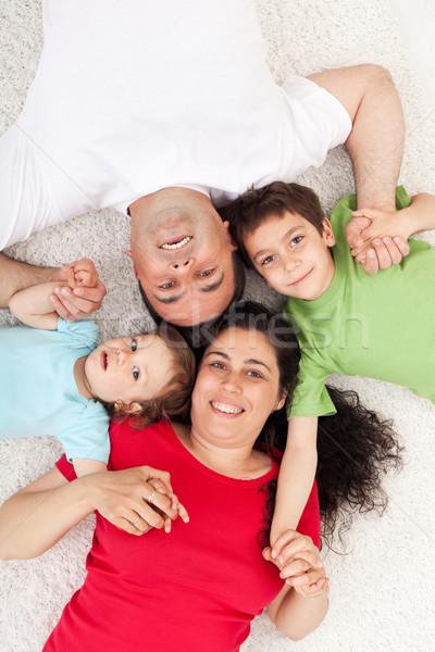 Happy family with two children Stock photo © ilona75