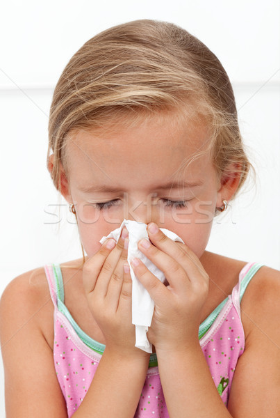Little girl with the flu blowing nose Stock photo © ilona75