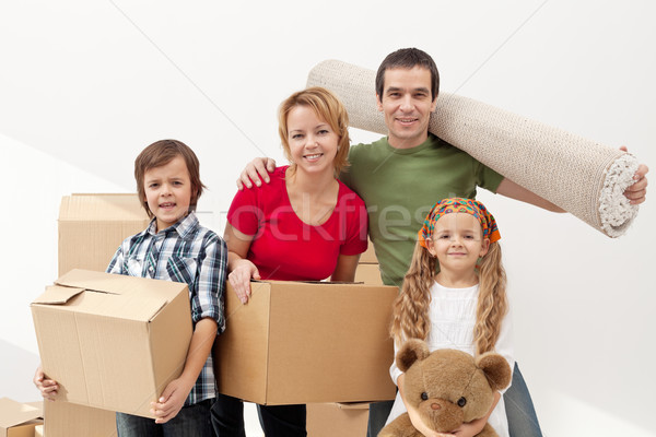 Stock photo: Happy family moving into a new home