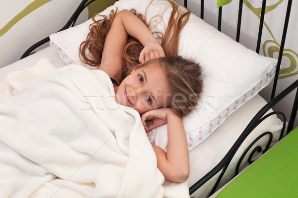 Young girl waking up with a smile Stock photo © ilona75