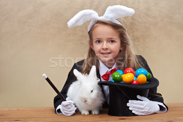 Magician girl bringing easter Stock photo © ilona75