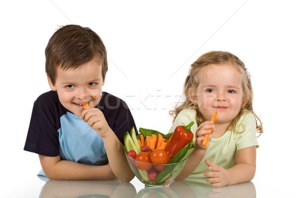 Happy kids eating vegetables Stock photo © ilona75