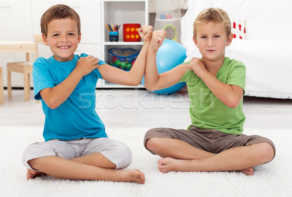 Meninos bíceps feliz saudável sorridente Foto stock © ilona75