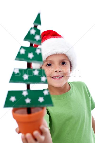 Happy kid holding christmas decoration Stock photo © ilona75