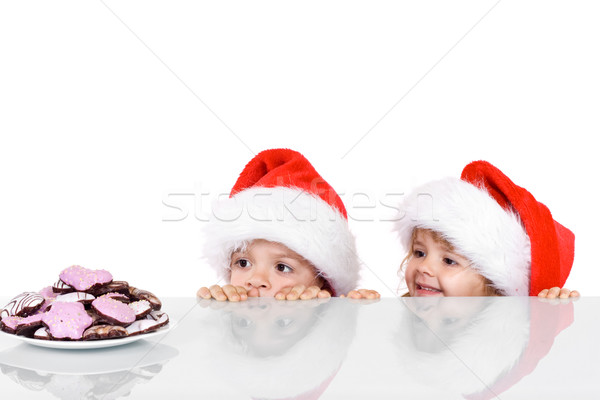 Two kids yearning for the christmas cookies Stock photo © ilona75
