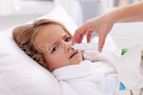 Little girl with bad cold using nasal spray Stock photo © ilona75