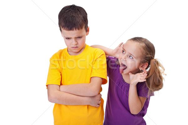 Fiatal lány gúny fiú nyelv kidugva izolált gyerekek Stock fotó © ilona75