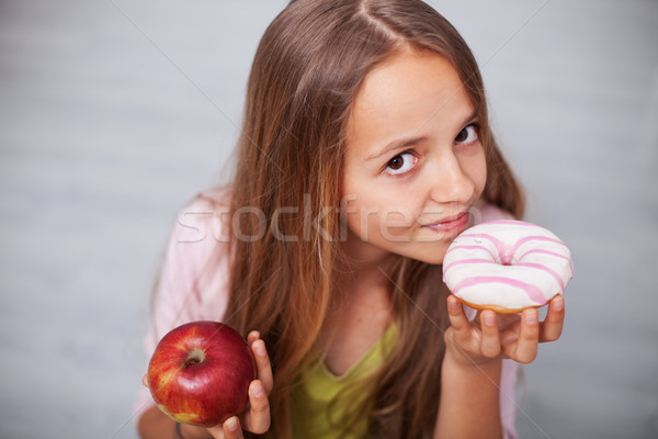 Young teenager girl craving sugary food Stock photo © ilona75