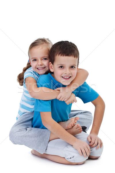 Happy wrestling kids Stock photo © ilona75