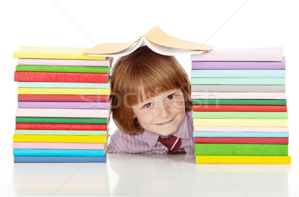 Stock photo: School boy with lots of colorful books