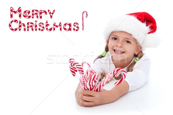 Zdjęcia stock: Dziewczynka · candy · Święty · mikołaj · hat · szczęśliwy · wakacje