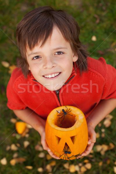 Boy with a Halloween pumpkin jack-o-lantern Stock photo © ilona75