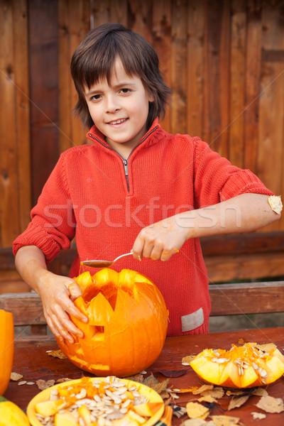 Boy carving his jack-o-lantern Stock photo © ilona75