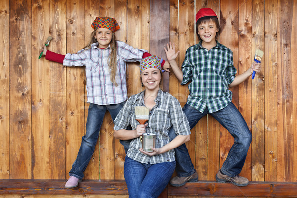 Stock photo: Family having fun repainting the wood shed