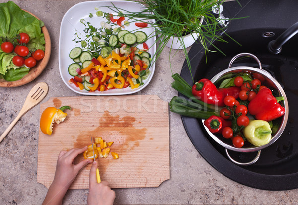 Hands chopping yellow bell pepper for a vegetable salad - health Stock photo © ilona75