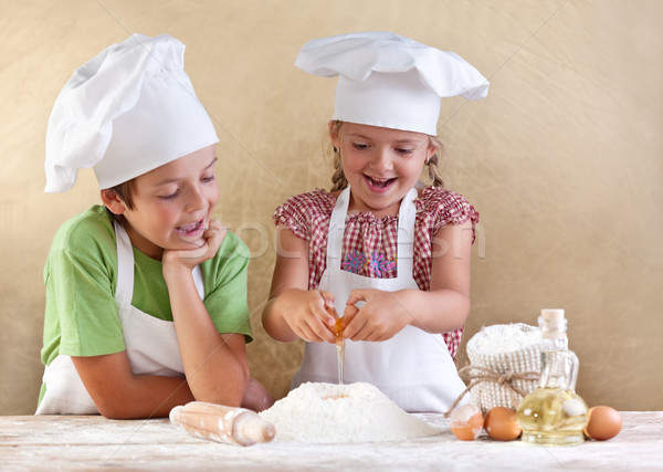 Kids preparing the dough for a cookie, pizza or pasta Stock photo © ilona75