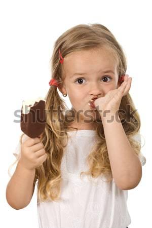 Little girl eating icecream licking fingers Stock photo © ilona75