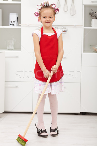 Little girl doing housekeeping work Stock photo © ilona75