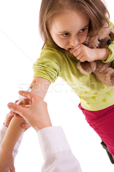 Little girl receiving an injection - studio shot - isolated Stock photo © ilona75