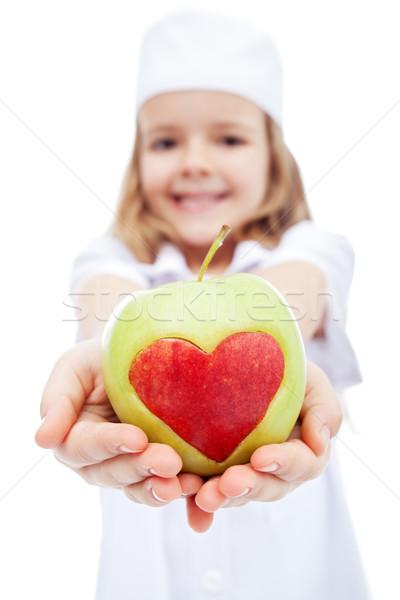 Little girl enfermeira maçã coração vida saudável mãos Foto stock © ilona75