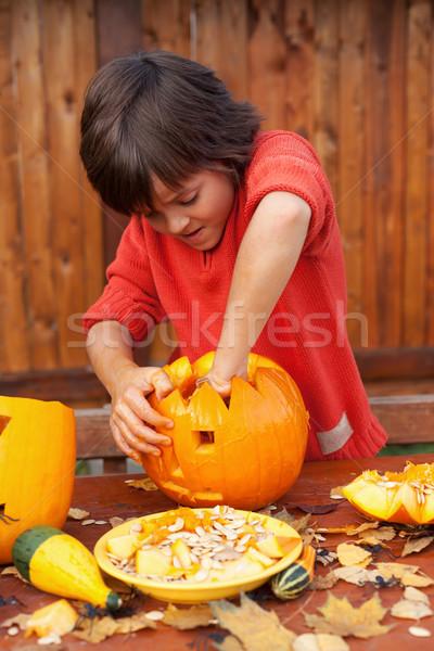Boy busy carving a pumpkin jack-o-lantern for Halloween Stock photo © ilona75